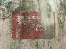 Inscription on the wall of an abandoned battery dugout Royalty Free Stock Photography
