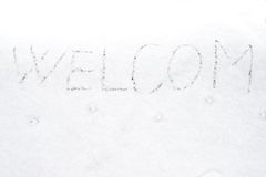 Inscription welcom on snow-covered ice Stock Image