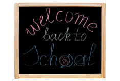 The inscription 'welcome back to school' written with colorful chalk on a school, black board stock photography
