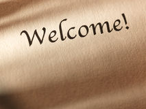The inscription Welcome on a sheet of paper. Stock Photography