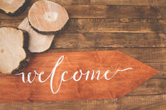 Inscription welcome on a wooden floor Stock Images