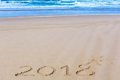 2018 inscription on wet beach sand and sea waves on background Royalty Free Stock Photography