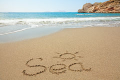 Inscription on wet sand. Sea written in a sandy tropical beach Stock Image
