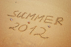 Inscription on wet sand Summer 2012 Stock Photo