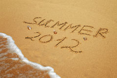 Inscription on wet sand Summer 2012 Royalty Free Stock Images