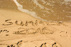Inscription on wet sand summer 2016. Concept photo the end of summer vacation Royalty Free Stock Image
