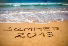 Inscription on wet sand Summer 2015. Concept photo of summer vacation Stock Photo