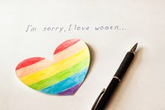 Inscription on white background I`m sorry I love women, heart in the form of a flag LGBT and a pen, lesbian. And bisexual stock image