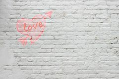 The inscription on the white brick wall stock photo
