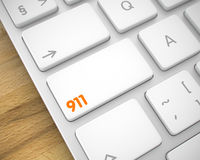 911 - Inscription on White Keyboard Keypad. 3D. Business Concept: 911 on the Slim Aluminum Keyboard lying on the Wood Background. 3D Render Royalty Free Stock Photography