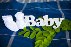 The inscription of white letters Baby Stock Photo