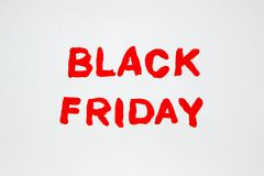 The inscription on a white sheet of paper. Black Friday. A 50% discount. Sale. The inscription painted Stock Images