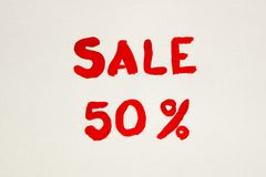 The inscription on a white sheet of paper. Black Friday. A 50% discount. Sale. The inscription painted Stock Photography
