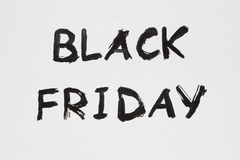 The inscription on a white sheet of paper. Black Friday. A 50% discount. Sale. The inscription painted Royalty Free Stock Images
