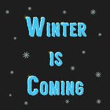 Inscription winter is coming with snowflakes Stock Photo