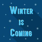 Inscription winter is coming with snowflakes and Royalty Free Stock Photo