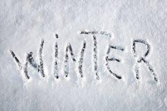 Inscription Winter made on snow Royalty Free Stock Photos