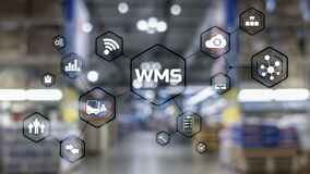 Free Inscription WMS On Blurred Warehouse Background. Werehouse Management System Stock Images - 217740004