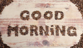 The inscription on wood good day with coffee beans Stock Photography