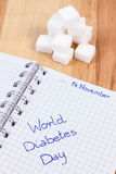 Inscription World diabetes day in notebook and sugar cubes, symbol of diabetic Stock Photo