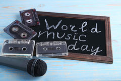 Inscription World Music Day. With microphone and cassette tapes on blackboard Stock Photography
