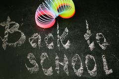 Chalk with words back to school. An inscription written in chalk back to school on an old blackboard Stock Photography