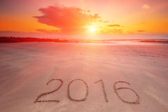 2016 inscription written in the wet yellow beach sand Royalty Free Stock Photos