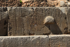 Inscriptions on a crepidoma at Delphi Royalty Free Stock Photos