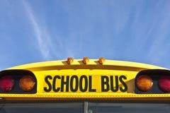 Inscriptions d'autobus scolaire et signaux lumineux Image stock