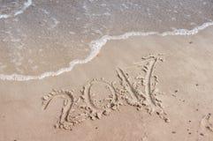 Inscriptions dans le sable en 2017 Photos libres de droits