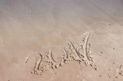 Inscriptions dans le sable en 2017 Photo stock