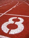 Inscriptions extérieures sportives -- Numéro huit photographie stock