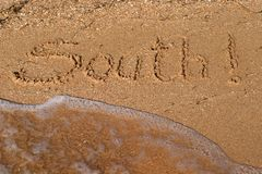 Inscriptions on the  sand Stock Images