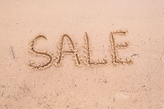 Inscriptions on the sand: sale Royalty Free Stock Photography