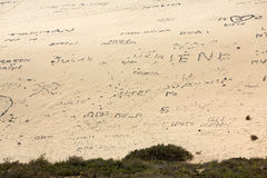 Inscriptions from stones on the beach Playa de Sotavento, Canary Island Fuerteventura Stock Images