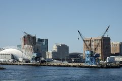 Insdustrial cranes. For boat on Boston's pier with skyline on the back, Boston, Mass USA stock photo