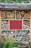 Insect home. With coloured roof made with wood on the garden. It used for attract good bugs insects for garden plants Stock Photos