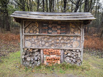 Insect hotel in autumn woodland. Insect santuary in a woodland park autumn forest Stock Photography