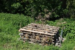 Insect hotel on community field in countryside Royalty Free Stock Image