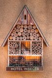 Insect hotel with compartments and natural components. Close view Royalty Free Stock Photos