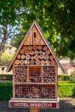 Insect hotel with compartments and natural components. Close view Royalty Free Stock Images