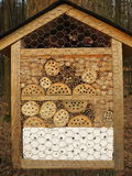 Insect hotel in forest Stock Image