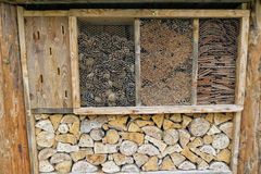 Insect hotel fullframe. Insect hotel for solitary wild bees and wasps Stock Photos