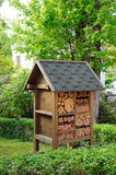 Insect hotel in garden Royalty Free Stock Images