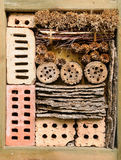 Insect hotel in garden Royalty Free Stock Photography