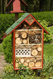 Insect hotel. An insect hotel in a green landscaped garden Royalty Free Stock Photo