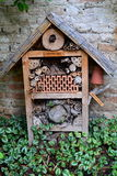 Insect hotel. In the vegetable garden royalty free stock photos