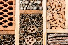Insect hotel for wild bees, butterfly . . . Stock Photos