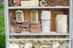 Insect hotel for wild solitary bees and other insects Royalty Free Stock Images
