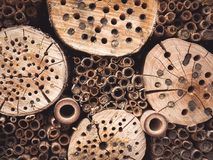 Insect hotel. Wooden insect hotel for different types of insects Stock Images